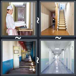 A lady with laundry in her hand, A stairway in the hall, A hallway with 1 door open, and A hall with doors on the walls