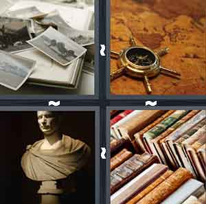 A bunch of old black and white pictures, An old map with a boat steering wheel on top of it, The top half of a statue, and A bunch of old books in a row
