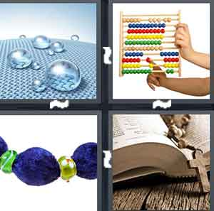 Virtual water drops, People playing with a colorful math toy, A piece of jewelry that has a big blue piece to it, and A book with Rosary Beads in the center