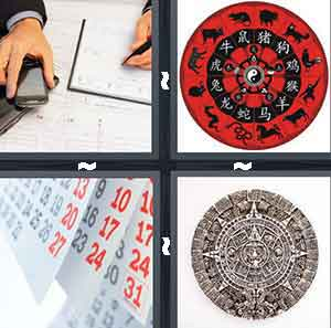 A person writing something in a notepad, A red circular object with animals and Chinese symbols on them, Sheets of white paper with black and red numbers on them, and A circular object